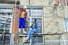 Couple building a house. Construction. Man and his wife building a house Stock Image