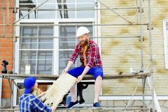 Couple building a house. Construction. Man and his wife building a house Royalty Free Stock Images