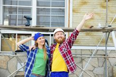 Couple building a house. Construction. Man and his wife building a house Stock Photos