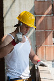 Construction Man Hitting Wood With Hammer Stock Images