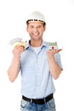 Construction man holding house model and money Royalty Free Stock Photo