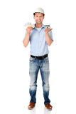 Construction man holding house model and money Royalty Free Stock Image
