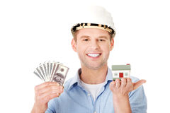 Construction man holding house model and money Royalty Free Stock Images