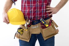 Construction man isolated, buider. Bricklayer with helmet and belt of tools isolated in background white stock photo