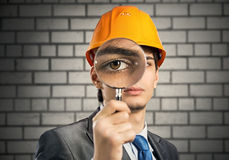 Construction man with magnifier Royalty Free Stock Photo