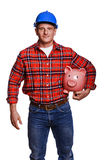 Construction man  with piggy bank. Stock Image