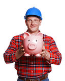 Construction man  with piggy bank. Stock Photography