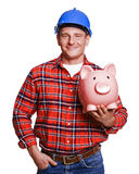 Construction man  with piggy bank. Royalty Free Stock Photo
