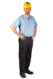 Construction Man Standing and Ready at an Angle. A blue collar worker standing, facing at an angle, strong with hands on hips. This man could be a technician Stock Images