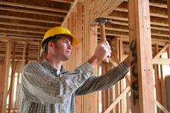 Construction Man Using Hammer stock photos