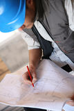 Construction manager analysing blueprint Royalty Free Stock Image