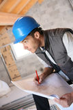 Construction manager analysing blueprint Stock Photography