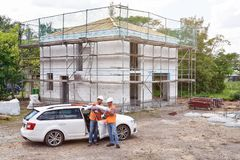 Construction manager and architect on site during the construction of a house - planning and control on site - teamwork stock images