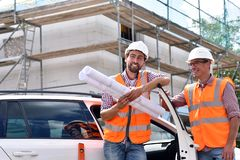 Construction manager and architect on site during the construction of a house - planning and control on site - teamwork royalty free stock images