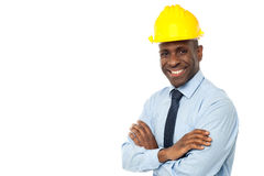 Construction manager with arms folded. Construction engineer in hard hat with his arms crossed stock photography