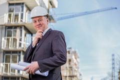 Construction manager with blueprints Stock Photos