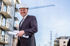 Construction manager with blueprints Stock Images