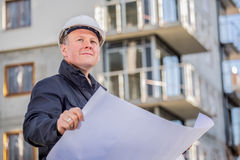 Construction manager with blueprints Royalty Free Stock Photography