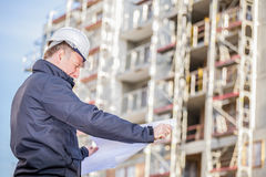 Construction manager with blueprints Royalty Free Stock Photo