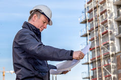Construction manager with blueprints Royalty Free Stock Images