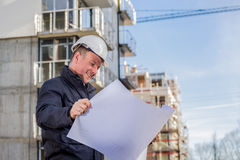 Construction manager with blueprints Stock Photo