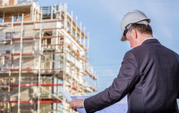 Construction manager with blueprints Royalty Free Stock Photos