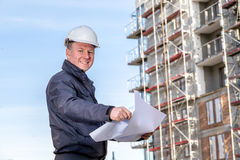 Construction manager with blueprints Royalty Free Stock Image