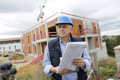 Construction manager on building site Stock Photo