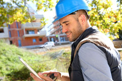 Construction manager on building site with tablet Royalty Free Stock Image