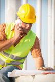Construction manager controlling building site with plan Royalty Free Stock Photo