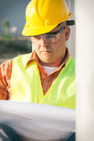 Construction manager controlling building site with plan Royalty Free Stock Photos
