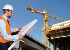 Construction manager/ engineer planning house construction. Closeup Stock Photography