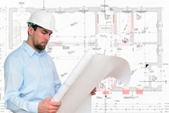 Construction manager/ engineer planning house construction. Drawing wall with details Royalty Free Stock Photography