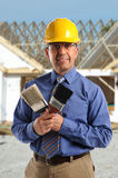 Construction Manager Holding Paintbrushes Stock Image