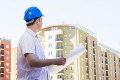 Construction manager holding project. And observed on building site Stock Photography