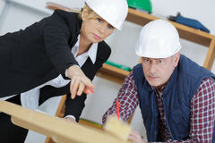 Construction manager instructs subordinate in workplace. Construction manager instructs a subordinate in the workplace Royalty Free Stock Image