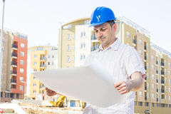 Construction manager looking project. On building site Stock Photos