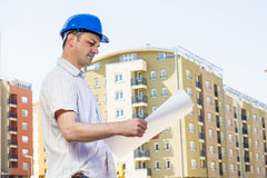 Construction manager looking project. On building site Royalty Free Stock Image