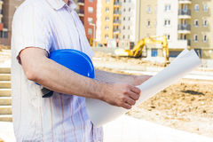 Construction manager looking project. On building site Stock Image
