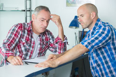 Construction manager resolving problem with colleague Royalty Free Stock Photo
