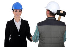 Construction manager and worker Stock Photo
