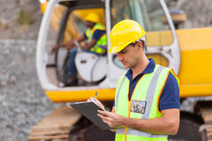 Construction manager. Writing report at construction site stock photo