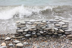 Construction of many pebbles on a sea coast Stock Image