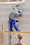 Construction mason renovating the facade of a house Royalty Free Stock Photo