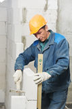 Construction mason worker bricklayer with level Stock Image