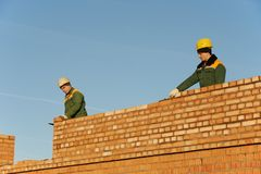 Construction mason worker bricklayers Stock Photo