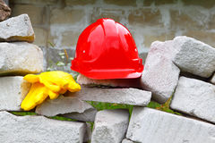 Construction.Masonry.The helmet and gloves. Objects and tools at industrial construction Stock Photos