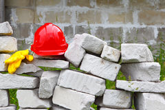 Construction.Masonry.The helmet and gloves. Objects and tools at industrial construction Stock Images