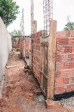 Construction of a masonry house. Construction, land under construction of a masonry house. Structure of reinforced concrete. House made of bricks, steel rebars stock photos