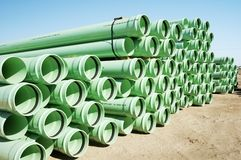 Construction Material. A bundle of sewer pipe at a residential home construction site Royalty Free Stock Images
